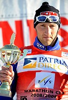 Marco Cattaneo of Italy celebrates his victory on the podium after the 50 kilometer cross_country skiing Marathon FIS Cup event ´Jizerska 50´ in Bedri...