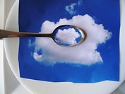 tea spoon with white cloud in it