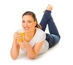 Young girl with orange juice isolated