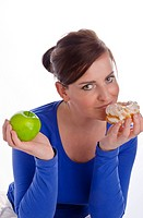 Woman with apple and biscuit