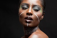 Close_up view of beautiful woman wearing tribal make_up paint