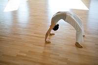 Woman doing wheel pose Urdhva Dhanurasana
