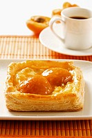 A pastry with apricots and ricotta