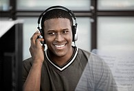 Black man listening to music on headphones
