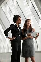 Businesswomen using digital tablet together