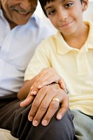 Hispanic grandfather and grandson holding hands