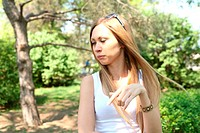 Portrait of sweet young woman enjoying at the park