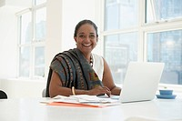 Indian businesswoman working at desk