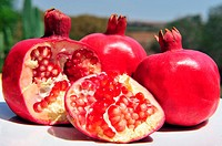 Pomegranate fruit with pips in an outdoor setting - Jewish new year symbols