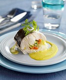 Hake filled with vegetables and served with saffron sauce