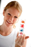 Woman holding medications.