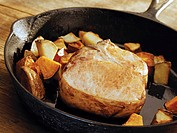 Pork Chop and Potatoes in a Cast Iron Skillet