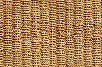 wicker basket with original pattern, straw background