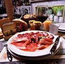 Piatto di salumi an appetizer platter of salami and raw ham