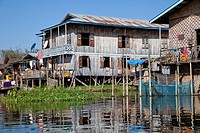 Myanmar, Burma  Traditional House on Stilts, Inle Lake, Shan State  Note blue satellite dish on left