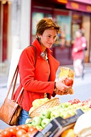 Woman buying fruits at the market.
