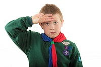 A 9 year old boy in his cub scout uniform in the Uk
