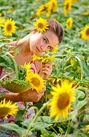 Woman in a sunflower field.