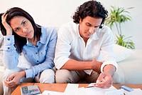 Sad couple checking their bills
