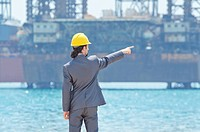 Oil engineer on sea side beach