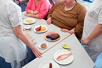 A nurse is holding a nutritional education workshop for obese patients. Limoges hospital offers its obese patients requiring hospitalization for five ...