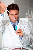 Laboratory technician working with a test tube