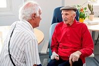 Centenarian person talking with his son. Residential home for dependent elderly person, Limoges, France.