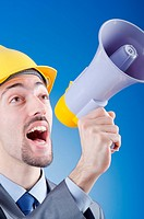 Construction worker shouting via loudspeaker