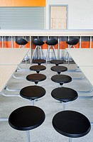 Rows of seats at tables in the dining hall of a modern secondary school