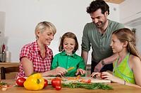 Germany, Bavaria, Nuremberg, Family cutting vegetables