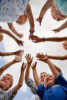 Germany, Bavaria, Group of children raising hands in air