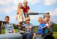 Germany, Bavaria, Group of children sitting in old tractor