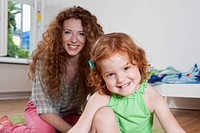 Germany, Berlin, Mother and daughter, smiling, portrait