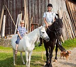 Germany, Bavaria, Mature woman and boy on horse