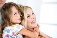 Germany, Mother and daughter smiling, close_up