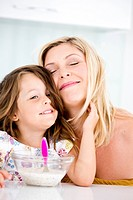Germany, Daughter touching mother, smiling