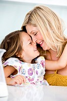 Germany, Mother and daughter smiling, close-up (thumbnail)