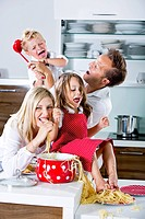 Germany, Family playing with spaghetti on kitchen worktop (thumbnail)
