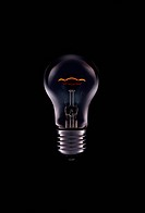 Turned on bulb lamp, black background
