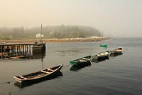 a foggy scene with fishing boats at Fox Point Nova Scotia Canada