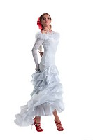 Pretty woman in white dress performing flamenco