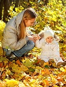 Mother with little daughter in autumn park