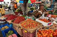 Woman selling chilli peppeers and vegetables, at the Pasar Badung market in Denpasar, Bali, Indonesia