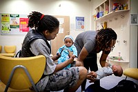 Reportage in a post_natal clinic in Champigny, France. Since leaving the neonatal unit, the twins 3_months old are checked every week to follow their ...