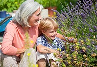Germany, Bavaria, Mature woman with boy in garden