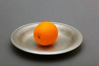 Orange on plate, close up