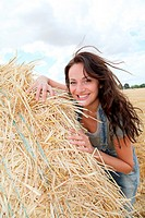 Beautiful woman laying down bale