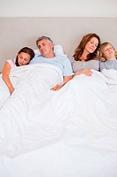 Family sleeping in the bedroom