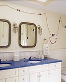 Bathroom with two mirrors and two sinks