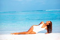 Portrait of glamorous young woman enjoying the peaceful nature on beach